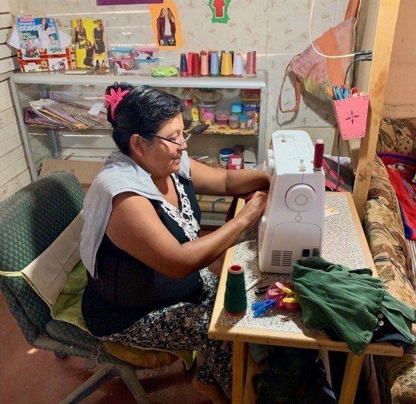 Woman at Sewing Machine